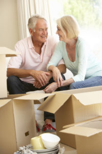 42400799 - senior couple moving home and packing boxes
